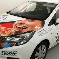 lettrage en semi covering pour la société Pizza Nostra Bailleul